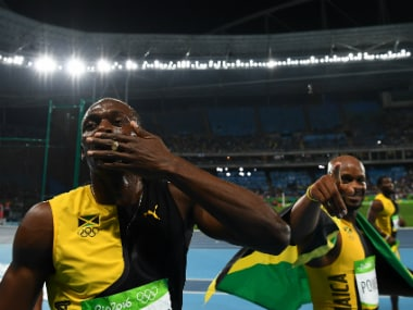Usain Bolt (L) and Asafa Powell (R). AFP