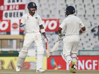 Virat Kohli and Parthiv Patel celebrate as India beat England on the fourth day of their third Test match. AP