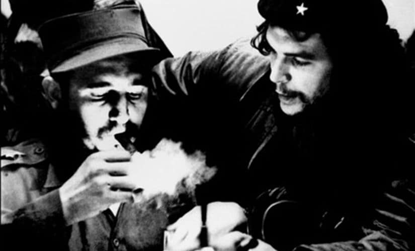 This file photo taken in the 1960s shows the then Cuban Prime Minister Fidel Castro (left) lighting a cigar with Argentine Ernesto Che Guevara. AFP