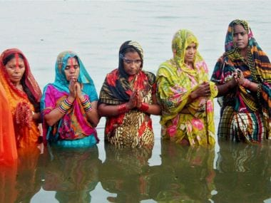 Devotees worshiping on the occasion of the Chhath festival on the banks of Ganga river at Varanasi  on Sunday. PTI