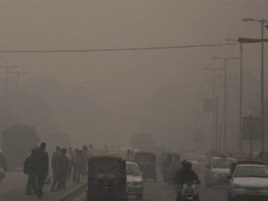 Streets of Delhi covered in smog. PTI