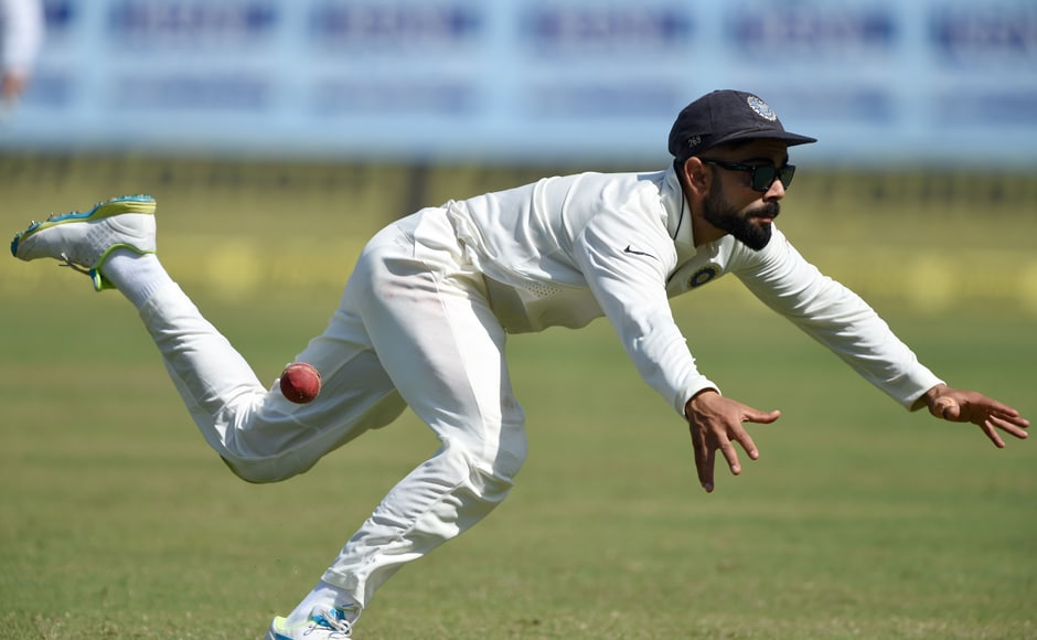 Indian captain Virat Kohli makes an unsuccessful attempt to field a ball off the batting of England's Ben Stokes during Day 2 of the 1st Test at Rajkot. AFP