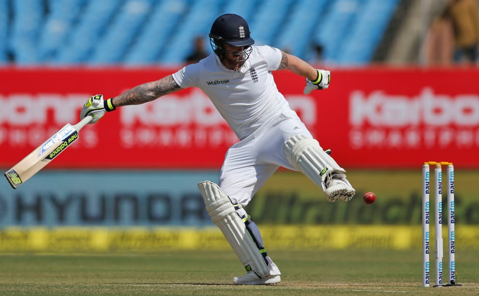England batsman Ben Stokes tries to stop the ball from hitting wickets during Day 2 of the 1st Test at Rajkot. AP