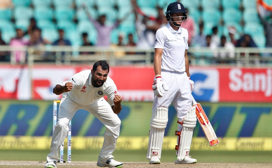 Mohammed Shami celebrates the dismissal of England's Joe Root on the last day of the second Test between India and England at Visakhapatnam. Root was the key man for England at the start of Day 5 and it was an inspired bowling change by Kohli to bring in Shami, and the pacer delivered for his captain. AP