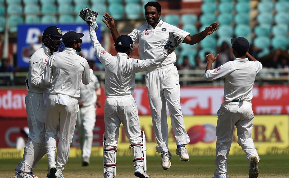Jayant Yadav (2R), who made a stellar debut, celebrates the wicket of Ben Stokes with teammates during Day 5 of the second Test between India and England at Vishakhapatnam. AP