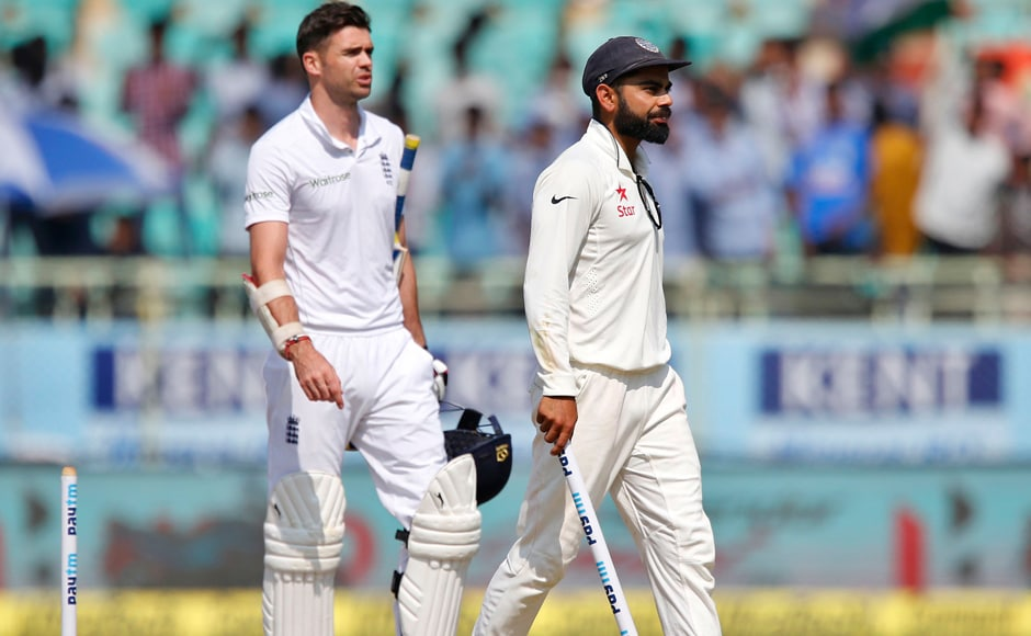 Virat Kohli carries a stump as he leaves the ground with England's James Anderson after India won their second Test at Visakhapatnam. AP