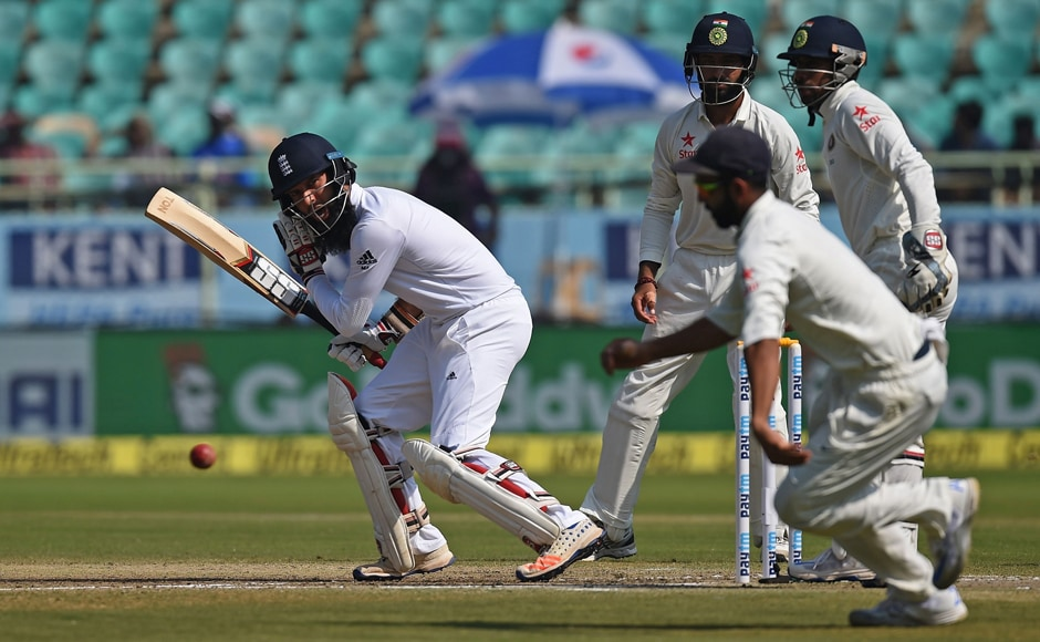 England's Moeen Ali (L) plays a shot during Day 5 of the second Test against India at Vishakhapatnam. AFP