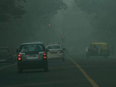 Vehicles on smog covered road in New Delhi. File photo. PTI