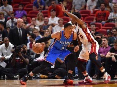 Dec 27, 2016; Miami, FL, USA; Oklahoma City Thunder guard Russell Westbrook (0) controls the ball around Miami Heat guard Josh Richardson (0) during the second half at American Airlines Arena. The Oklahoma City Thunder defeat the Miami Heat 106-94. Mandatory Credit: Jasen Vinlove-USA TODAY Sports - RTX2WOE4