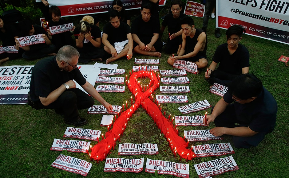 Awareness campaigns were organised across Phillipines as well, as people lit candles around the AIDS symbol at an event in observance of World AIDS Day in Quezon city. The group is calling for increased awareness to the rising number of HIV infections and AIDS-related cases and called on the government and other sectors to help break the social stigma brought about by the disease. AP