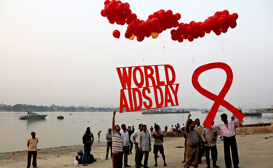 Activists prepare to release campaign materials into the air ahead of World AIDS Day on the banks of the Ganges River in Kolkata, India on Wednesday. World AIDS Day is celebrated on 1 December every year to raise awareness about HIV/AIDS and to demonstrate international solidarity in the face of the pandemic. AP