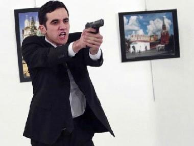 Gunman shoots down Russian Ambassador in Ankara, Turkey. AP