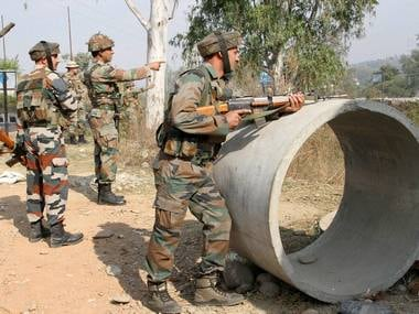 Security personnel take positions during a gun battle with suspected militants at Army camp at Nagrota near Jammu on Tuesday. PTI