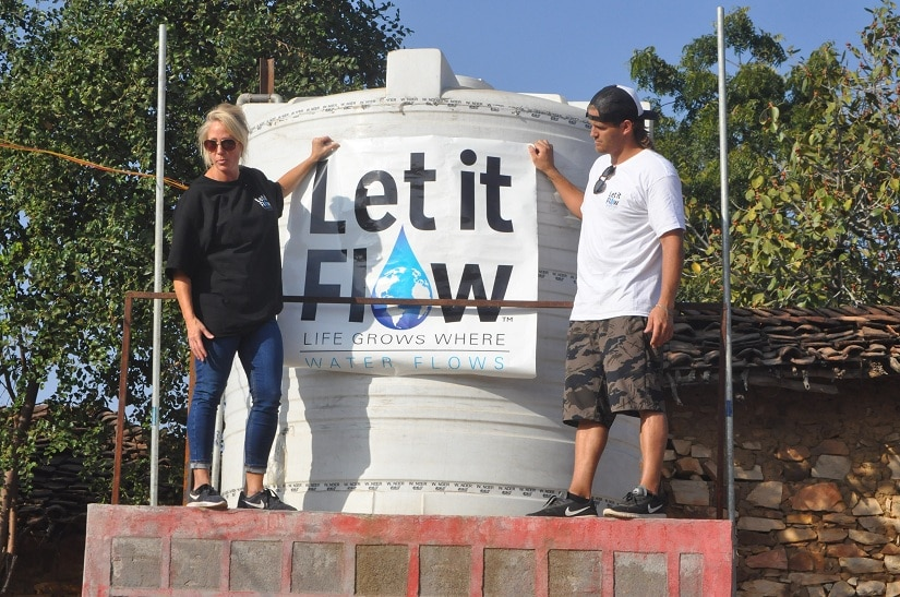 Kelle and Cody put up the Let it Flow banner at Janwaar