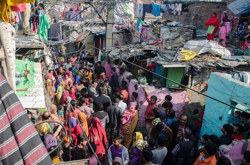 Narrow lanes of the slum where people gathered to protest