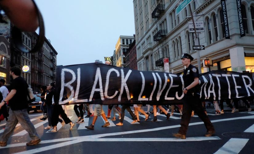 People take part in a protest against police brutality and in support of Black Lives Matter during a march in New York. Reuters