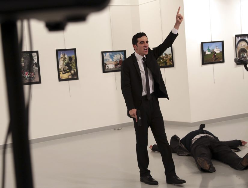 An unnamed gunman shouts after shooting the Russian Ambassador to Turkey, Andrei Karlov, at a photo gallery in Ankara. AP