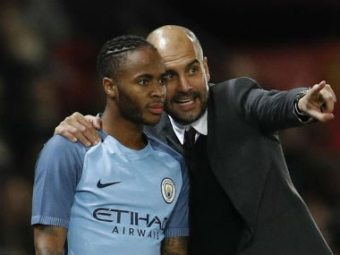 File photo of Pep Guardiola (R) and Raheem Sterling. Reuters