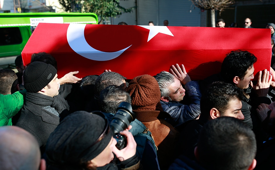 Mourners carry the Turkish flag-draped coffin of Fatih Cakmak, one of the victims of the attack. Of the 39 dead, 27 were foreigners, mainly from Arab countries, with coffins repatriated overnight to countries including Lebanon and Saudi Arabia. The Islamic State group has claimed the massacre, the first time it has clearly stated being behind a major attack in Turkey. AP