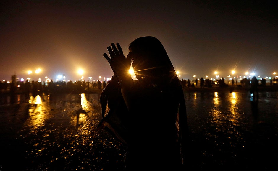 A Hindu pilgrim offers prayers after taking a dip in the Ganges river ahead of the one-day festival of Makar Sankranti, at Sagar Island, south of Kolkata, on 13 January, 2017. Reuters