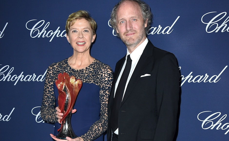 Annette Bening, winner of the Career Achievement award for '20th Century Women', poses backstage with presenter Mike Mills at the 28th annual Palm Springs International Film Festival Awards Gala. AP Photo