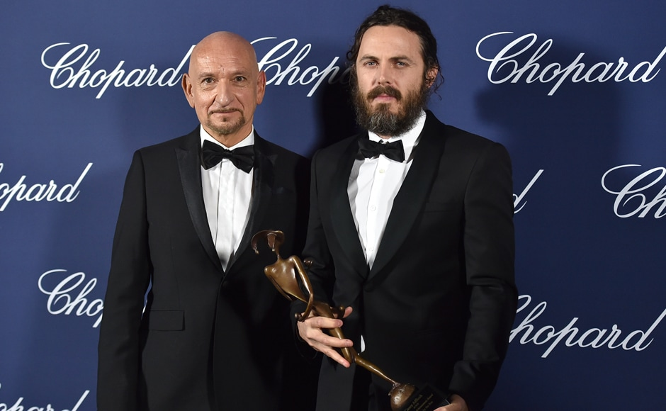 Casey Affleck, winner of the Desert Palm Achievement actor award for 'Manchester by the Sea', poses backstage with presenter Ben Kingsley at the 28th annual Palm Springs International Film Festival Awards Gala. AP Photo