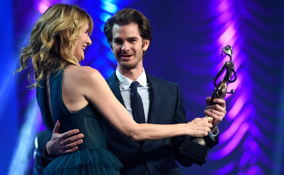 Laura Dern, left, presents the spotlight award to Andrew Garfield for 'Hacksaw Ridge' at the 28th annual Palm Springs International Film Festival Awards Gala on Monday, 2 January 2017, California. AP Photo