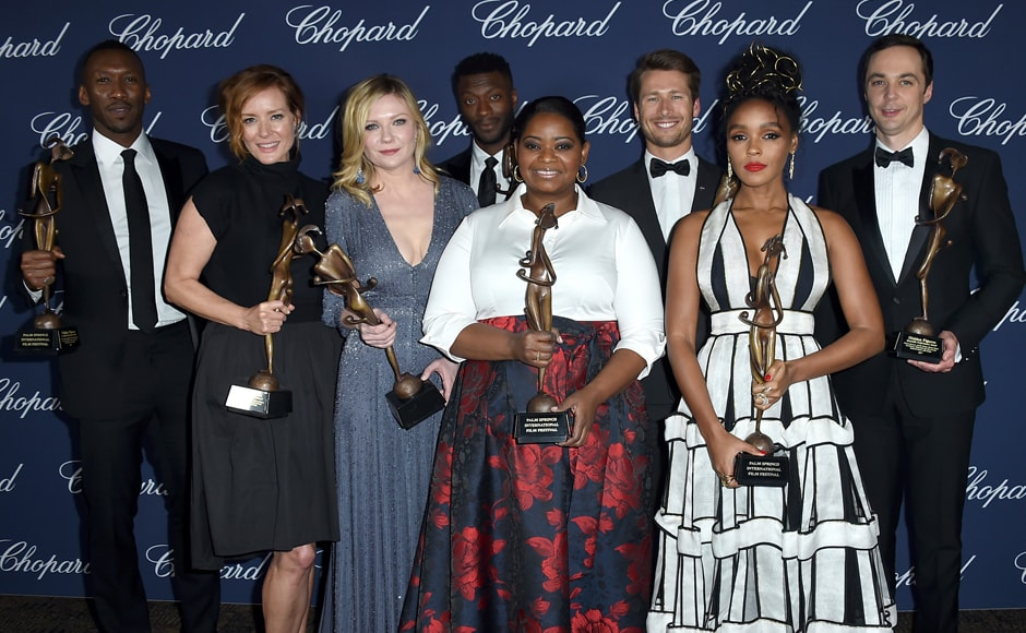 The cast of 'Hidden Figures' pose backstage with the ensemble performance award at the 28th annual Palm Springs International Film Festival Awards Gala on Monday, 2 January 2017. (L-R) Mahershala Ali, Kimberly Quinn, Kirsten Dunst, Aldis Hodge, Octavia Spencer, Glen Powell, Janelle Monae and Jim Parsons. AP Photo