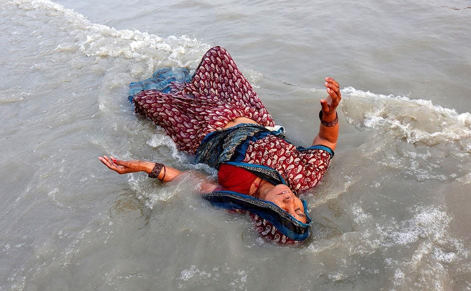 A Hindu pilgrim takes a dip in the Ganges river ahead of the one-day festival of Makar Sankranti, at Sagar Island, in Kolkataon 13 January, 2017. Reuters