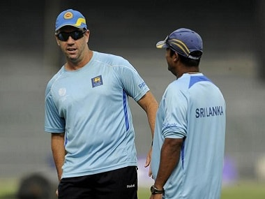 Sri Lanka's batting coach Stuart Law watches a training session in conversation with Muttiah Muralitharan (R) in Colombo before the ICC cricket World cup quarter final against England March 24, 2011. Law has been promoted to interim head coach of Sri Lanka for their tour of England. Picture taken March 24, 2011. REUTERS/Philip Brown (SRI LANKA - Tags: SPORT CRICKET)