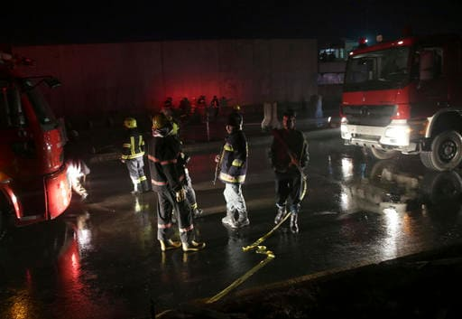 Afghan firefighters wash the site of a twin bombing in Kabul, Afghanistan, Tuesday, Jan. 10, 2017. Afghan officials say two large bombings near government offices in the capital have killed many people. (AP Photos/Massoud Hossaini)