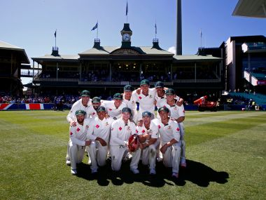Australia's captain Steve Smith holds the trophy as he poses with team mates on the Sydney Cricket Ground. Reuters