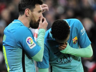 Barcelona's Argentinian forward Lionel Messi (L) and teammate Brazilian forward Neymar da Silva Santos Junior speak during the Spanish Copa del Rey (King's Cup) round of 16 first leg football match Athletic Club Bilbao vs FC Barcelona at the San Mames stadium in Bilbao on January 5, 2017. AFP