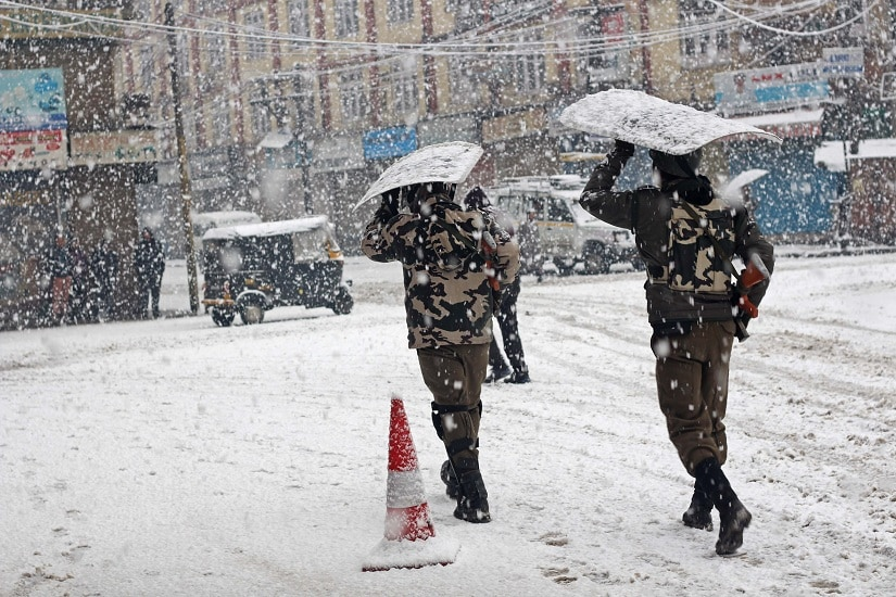 CRPF soldiers taking cover from heavy snow in the Lal Chowk area of Srinagar. Photo courtesy Faisal Khan
