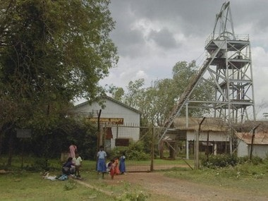 Schoolchildren play in front of an abandoned shaft at Kolar Gold Fields, located in the southern Indian state of Karnataka September 9, 2011. Reuters