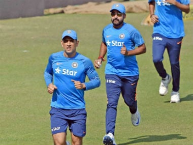 MS Dhoni with team-mates during the optional practice session ahead of the 3rd ODI at Kolkata. PTI