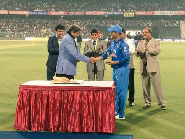MS Dhoni being felicitated at Eden Gardens as Sourav Ganguly looks on. Image courtesy: Twitter/BCCI