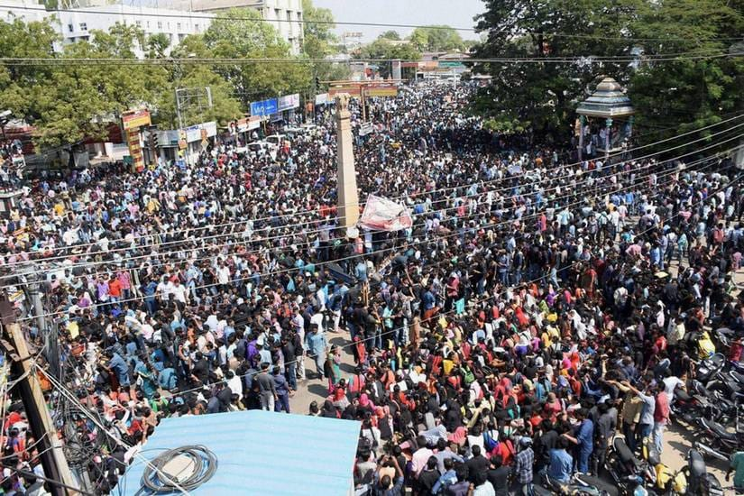 Thousands at a protest rally demanding the Central Government lift the ban against Jallikattu, near Tamukkam in Madurai on Wednesday. PTI