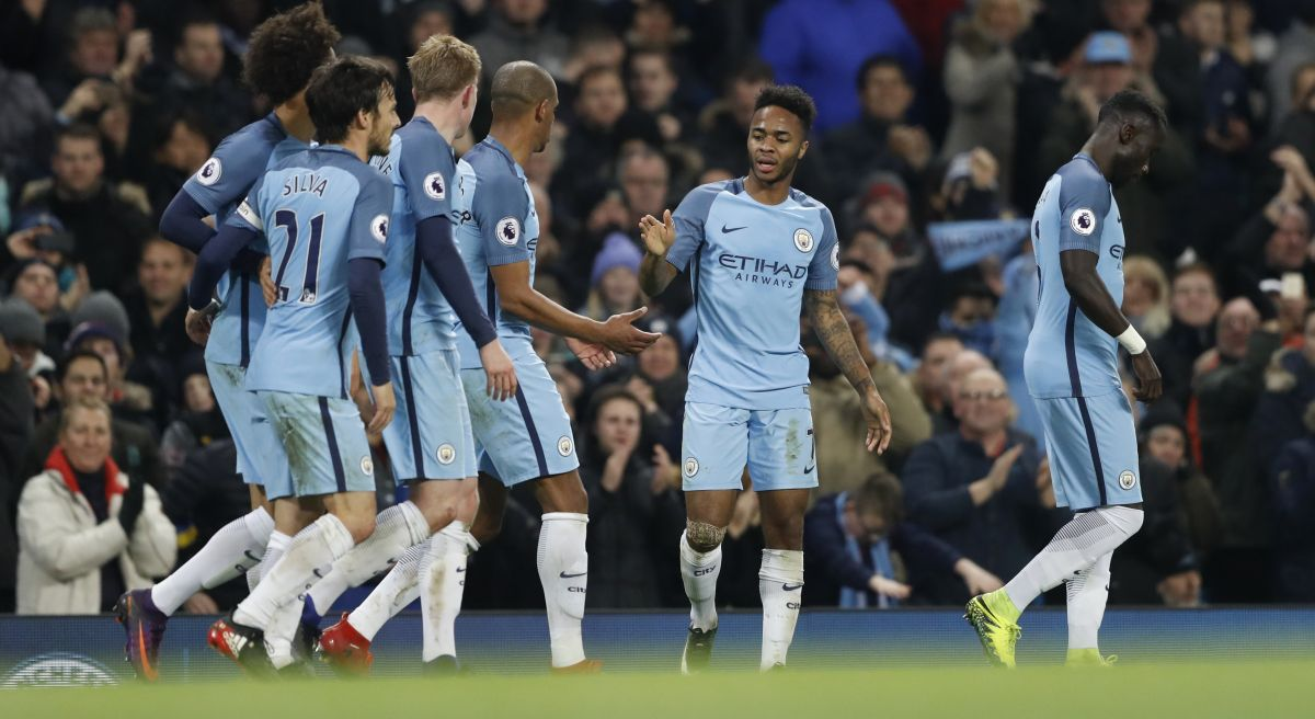 "Britain Football Soccer - Manchester City v Arsenal - Premier League - Etihad Stadium - 18/12/16 Manchester City's Raheem Sterling celebrates scoring their second goal with team mates Action Images via Reuters / Carl Recine Livepic EDITORIAL USE ONLY. No use with unauthorized audio, video, data, fixture lists, club/league logos or ""live"" services. Online in-match use limited to 45 images, no video emulation. No use in betting, games or single club/league/player publications. Please contact your account representative for further details. - RTX2VK7I"