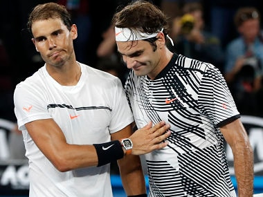 Roger Federer, right, is congratulated by Rafael Nadal, after Federer won the men's singles final at the Australian Open. AP