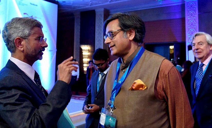 Foreign Secretary S Jaishanker interacting with former external affairs minister Shashi Tharoor at the second edition of the Raisina Dialogue. PTI