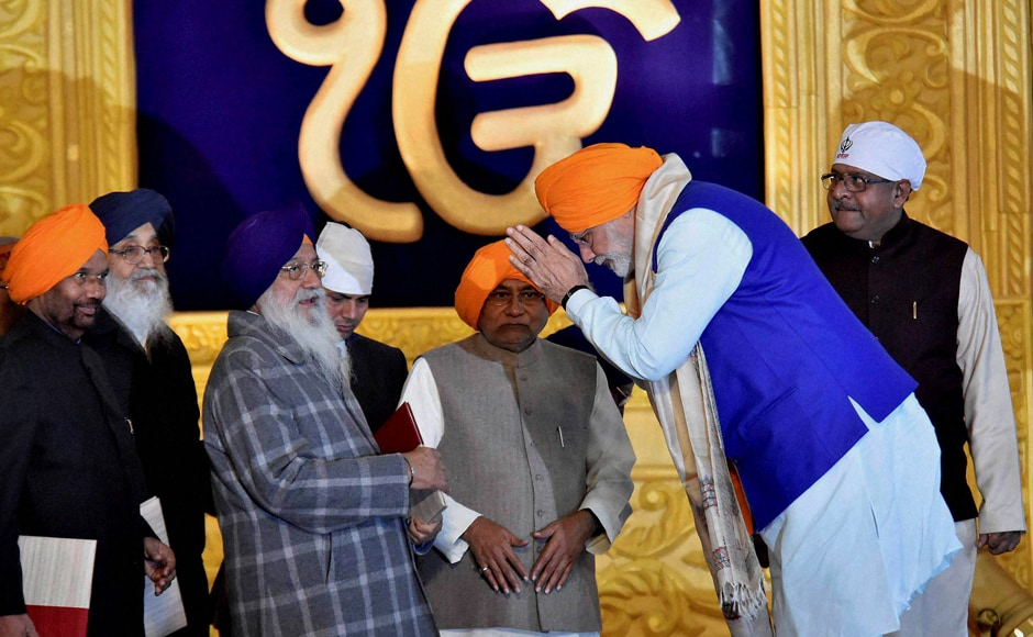 Prime Minister Narendra Modi with Bihar Chief Minister Nitish Kumar, Punjab Chief Minister Parkash Singh Badal and Union Minister for Law and IT Ravi Shankar Prasad and Union minister Ramvilas Paswan participate in the 350th birth anniversary celebrations of Guru Gobind Singh at Gandhi Maidan in Patna on Thursday. PTI