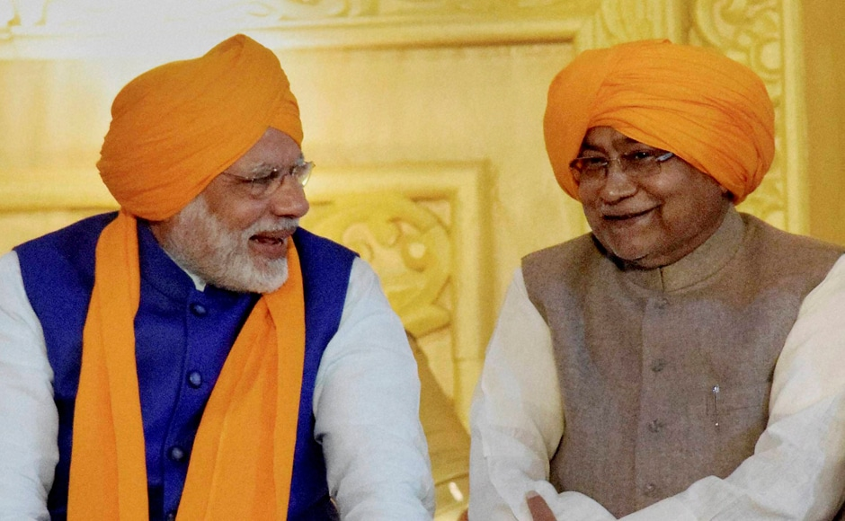 Prime Minister Narendra Modi and Bihar Chief Minister Nitish Kumar share lighter moments during 350th birth anniversary celebrations of Guru Gobind Singh at Gandhi Maidan in Patna on Thursday. PTI