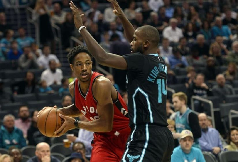 Jan 20, 2017; Charlotte, NC, USA; Toronto Raptors guard forward DeMar DeRozan (10) looks to pass as he is defended by Charlotte Hornets forward Michael Kidd-Gilchrist (14) during the first half of the game at the Spectrum Center. Mandatory Credit: Sam Sharpe-USA TODAY Sports