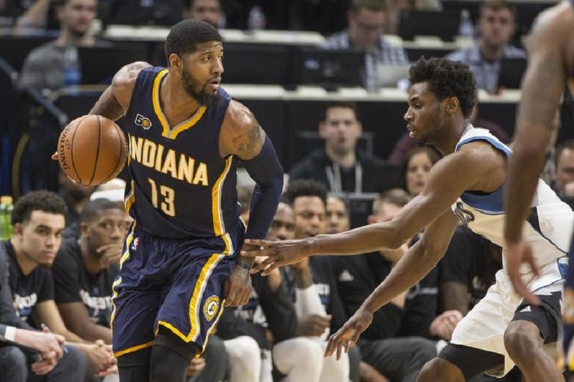Jan 26, 2017; Minneapolis, MN, USA; Indiana Pacers forward Paul George (13) looks to pass the ball as Minnesota Timberwolves forward Andrew Wiggins (22) defends in the second half at Target Center. The Pacers won 109-103. Mandatory Credit: Jesse Johnson-USA TODAY Sports