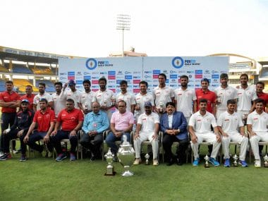 Gujarat cricket team pose with GCA officials after their Ranji trophy title victory over Mumbai. PTI