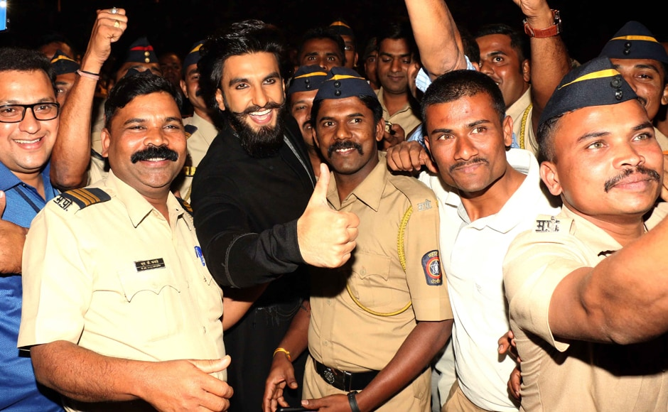 Ranveer and Mumbai's policemen pose for the shutterbugs together. Photo: Sachin Gokhale/Firstpost