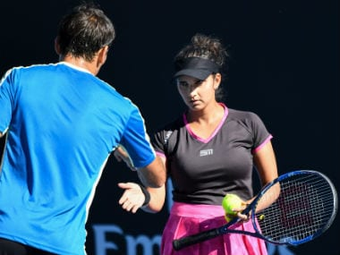 Sania Mirza celebrates a point with mixed doubles partner Ivan Dodig during their Round 1 match. AFP
