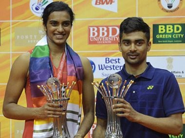 PV Sindhu (Women singles) and Sameer Verma (Men's singles) with their trophies after wining the Syed modi International GP Gold. PTI