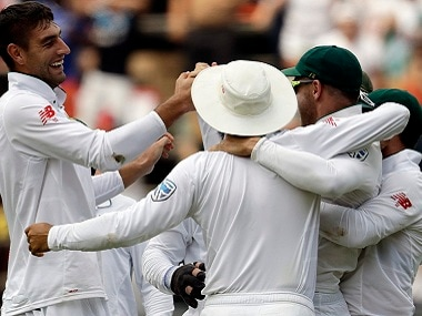 South African players celebrate after a wicket. AP